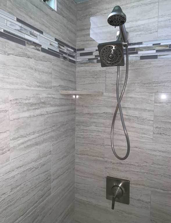 Two shower heads, one is a handheld shower head