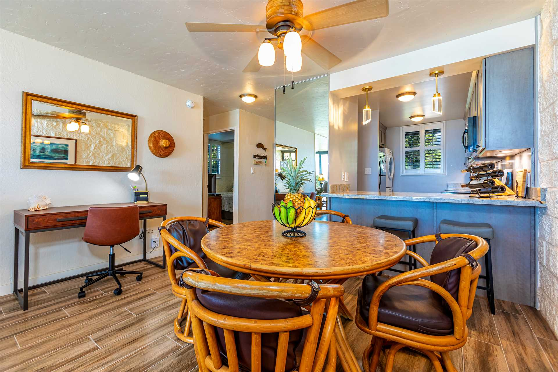 Dining area with kitchen counter pass thru. Also a desk and