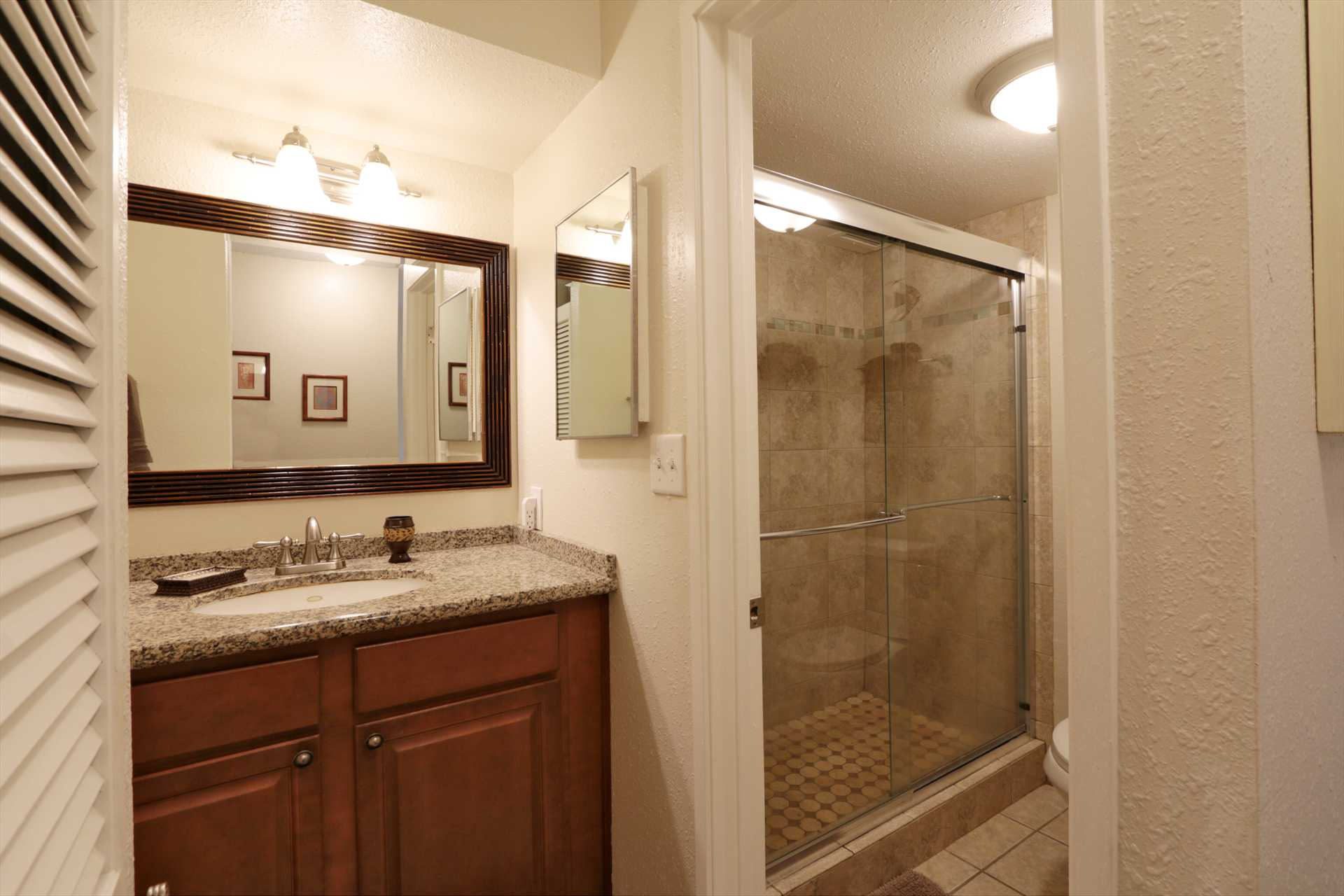 Vanity area and shower in C516