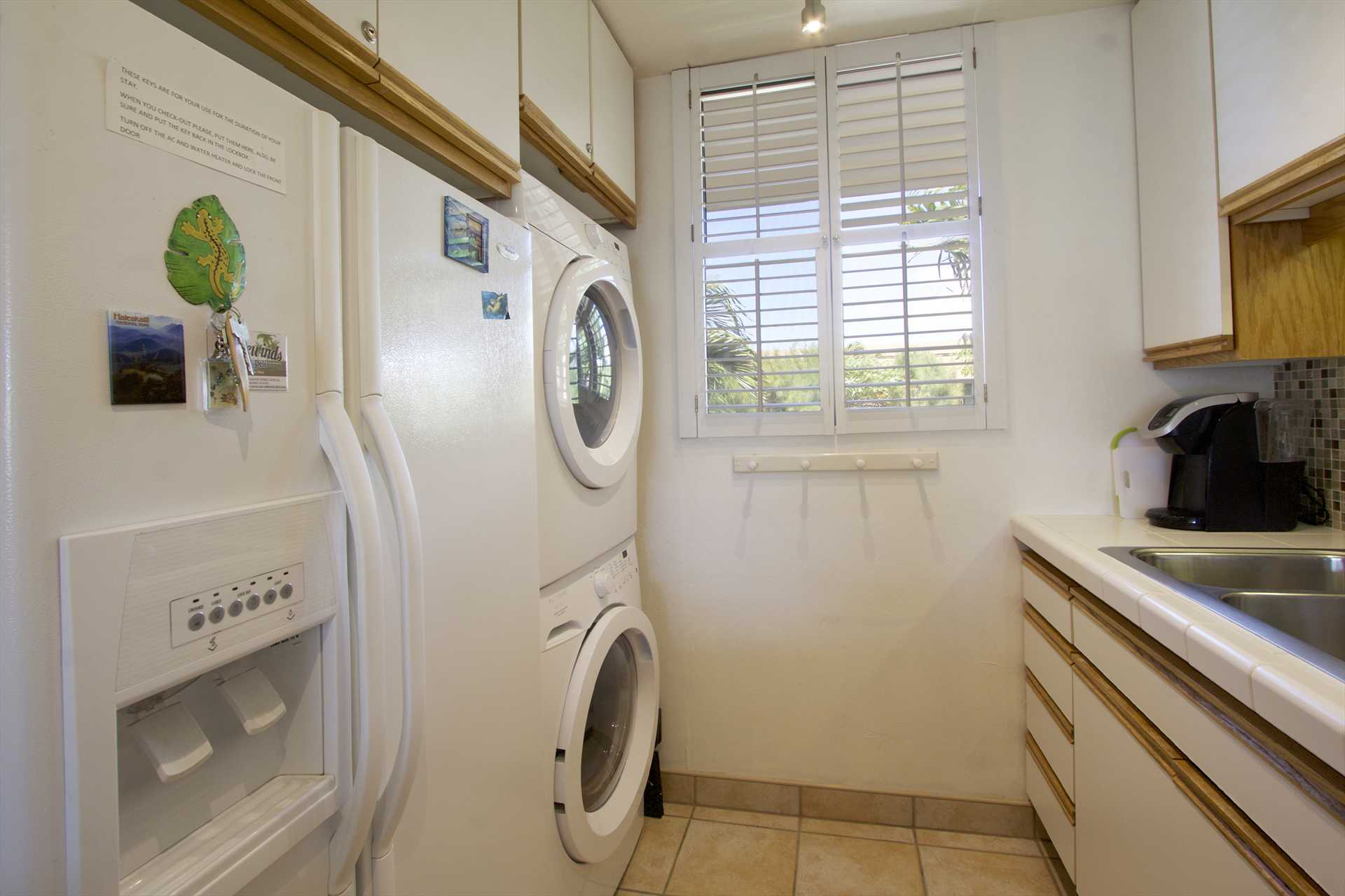 Kitchen with in-unit washer and dryer for convenience