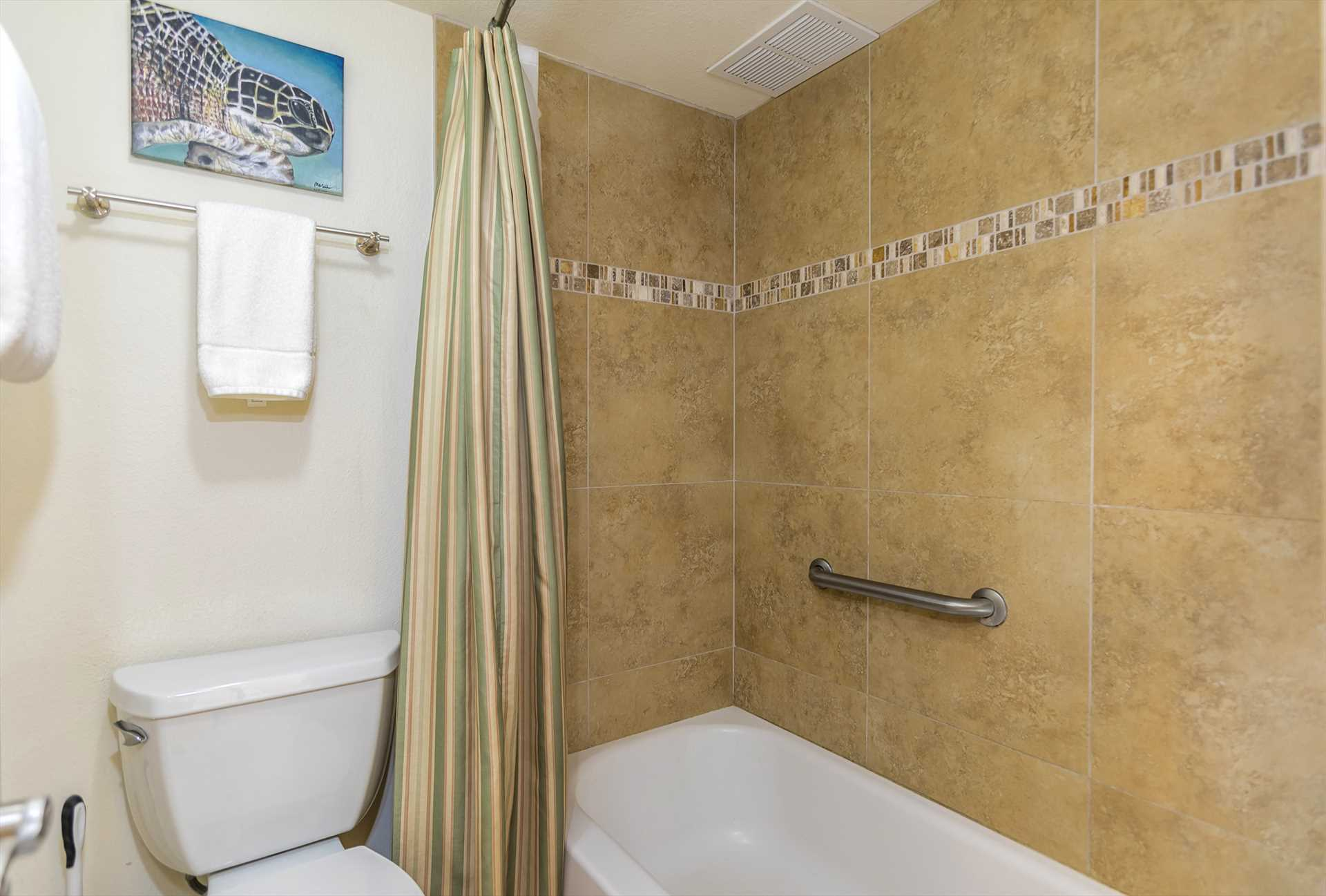 Bathtub and shower combination in bathroom