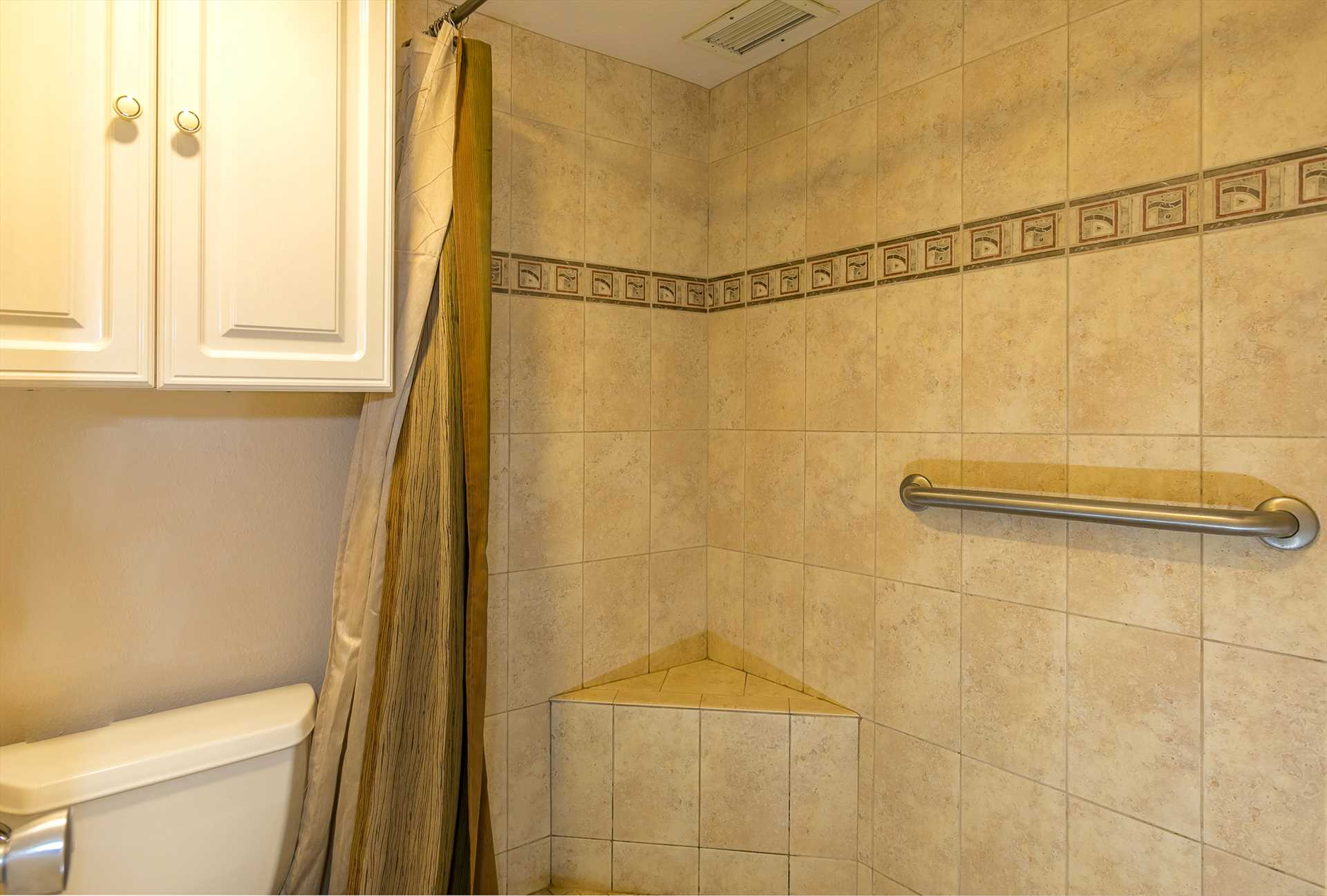 Tiled shower with built-in shower seat in C505