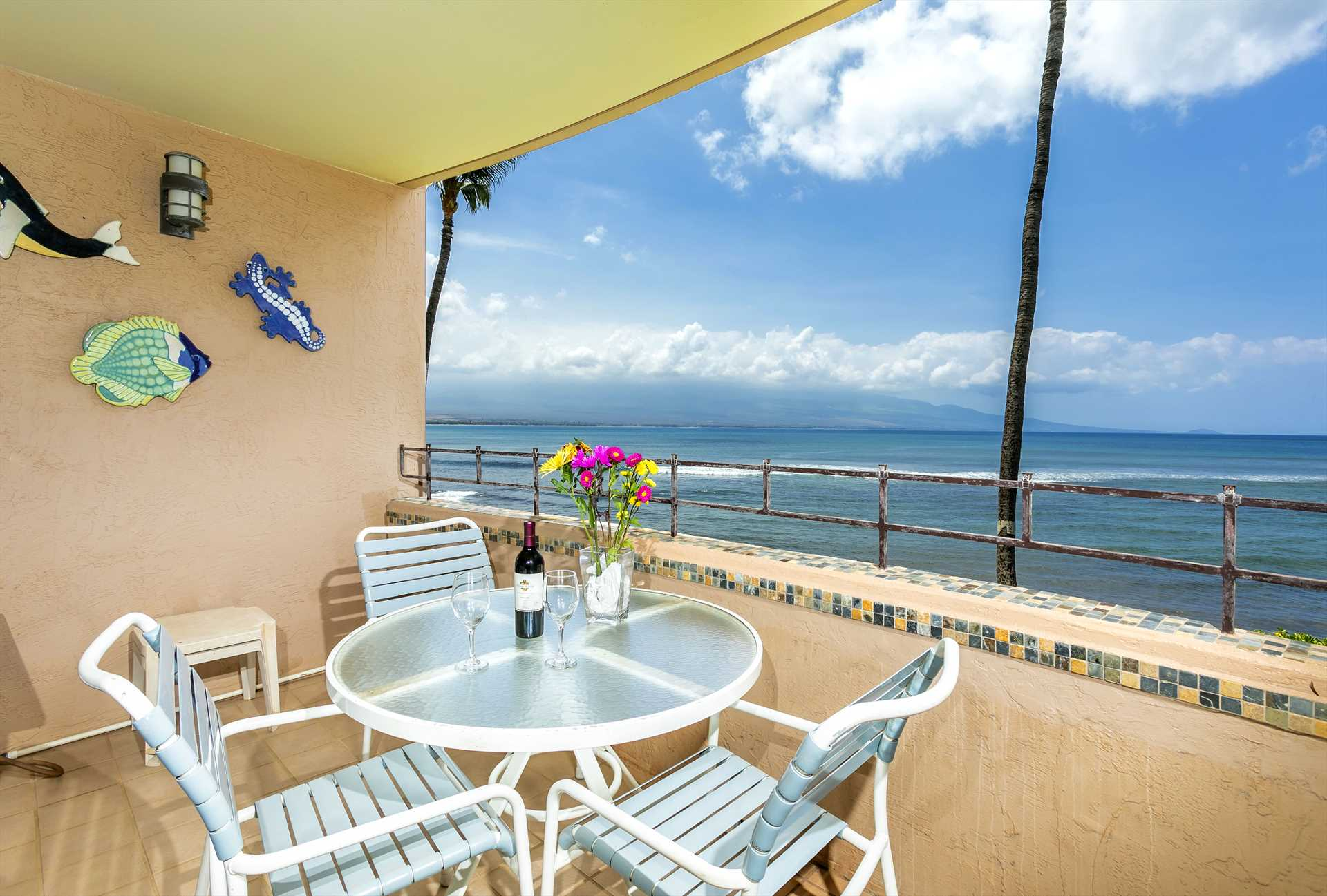 Enjoy epic sunsets from the oceanfront lanai