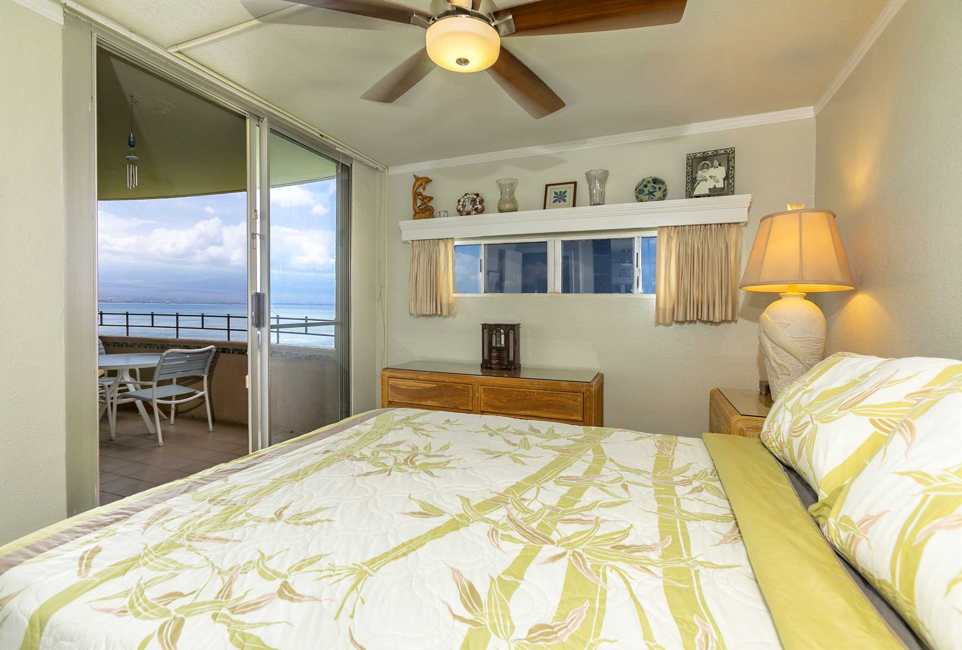 Comfortable bed with slider to oceanfront lanai