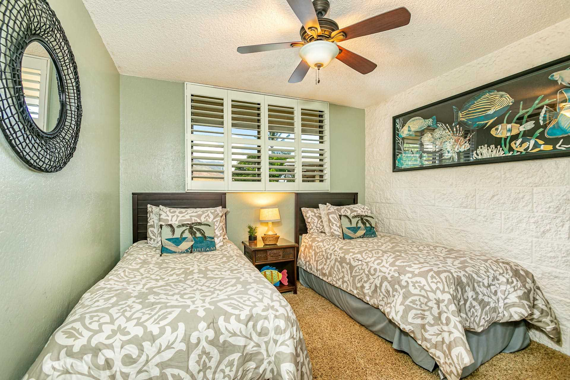 Second bedroom has two comfortable single beds and flat scre