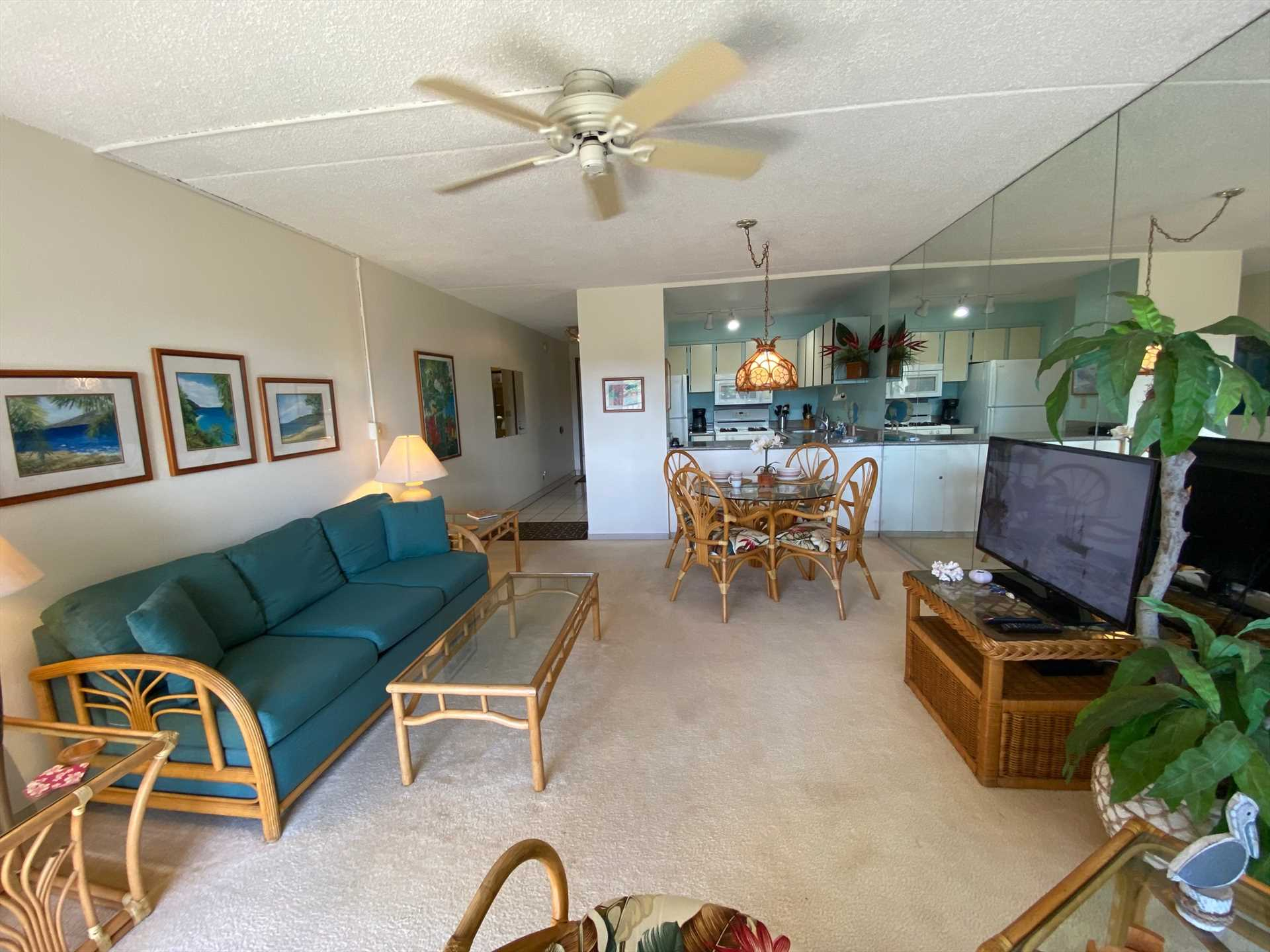 Unit 406 - Living Room includes large screen TV with basic c
